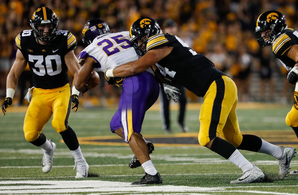 Iowa Hawkeyes defensive end A.J. Epenesa (94) makes a tackle during a game against Northern Iowa at Kinnick Stadium on September 15, 2018. (Tork Mason/hawkeyesports.com)