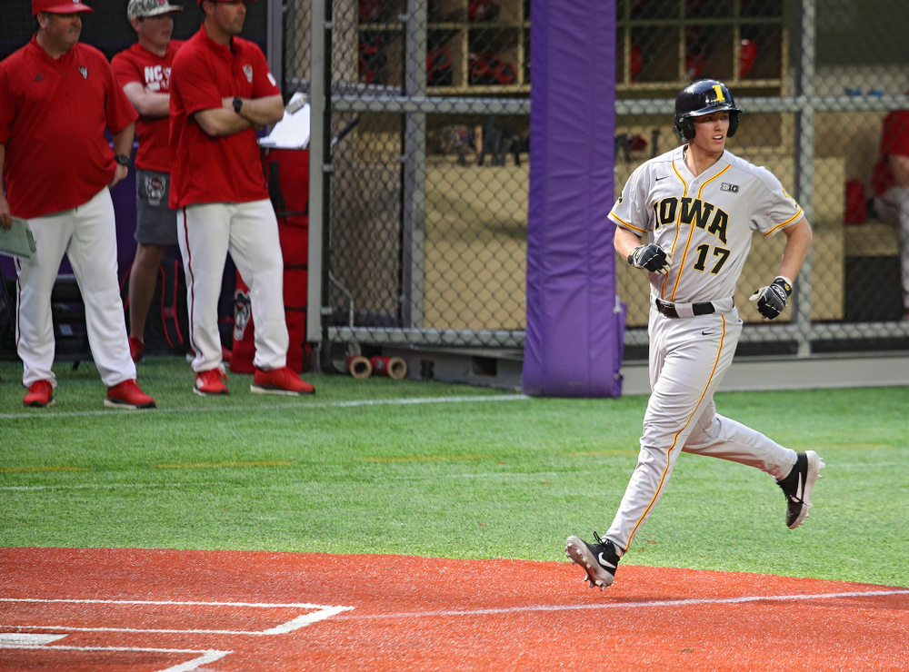 Iowa Hawkeyes infielder Dylan Nedved (17) scores a run during the seventh inning of their CambriaCollegeClassic game at U.S. Bank Stadium in Minneapolis, Minn. on Friday, February 28, 2020. (Stephen Mally/hawkeyesports.com)
