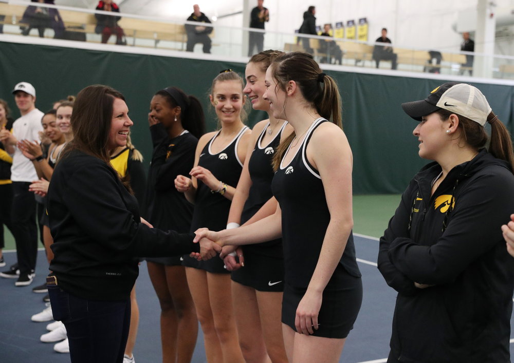 Academic Student Services Associate Director Kara Park congratulates Samantha Mannix for earning a 3.0 GPA or better during the fall semester before their match against the Penn State Nittany Lions Sunday, February 24, 2019 at the Hawkeye Tennis and Recreation Complex. (Brian Ray/hawkeyesports.com)