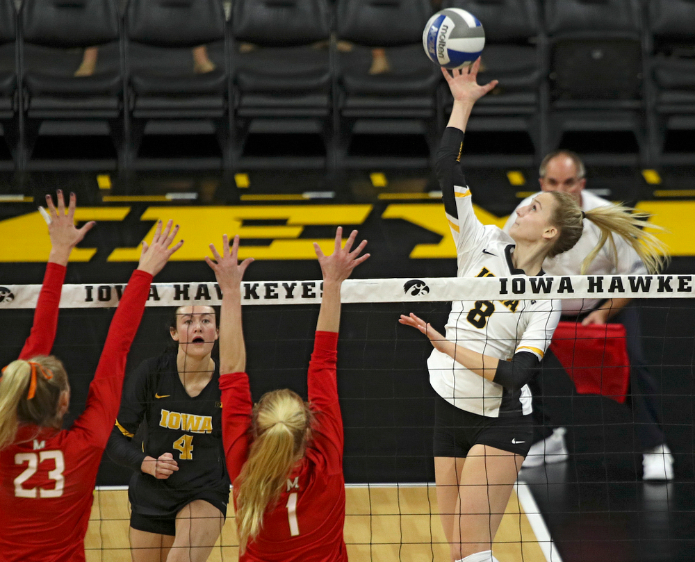 Iowa's Kyndra Hansen (8) gets up for a shot during the first set of their match at Carver-Hawkeye Arena in Iowa City on Saturday, Nov 30, 2019. (Stephen Mally/hawkeyesports.com)
