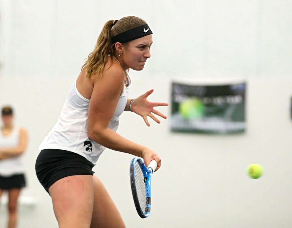Iowa's Ashleigh Jacobs returns a shot during her doubles match at the Hawkeye Tennis and Recreation Complex in Iowa City on Sunday, February 23, 2020. (Stephen Mally/hawkeyesports.com)