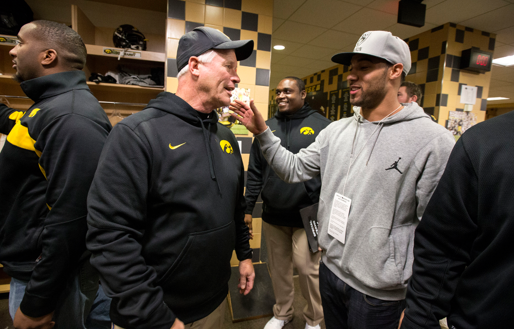 Iowa Hawkeyes defensive line coach Reese Morgan talks with Green Bay Packer Michah Hyde during the second half of their game Saturday, Nov. 1, 2014 at Kinnick Stadium.  (Brian Ray/hawkeyesports.com)