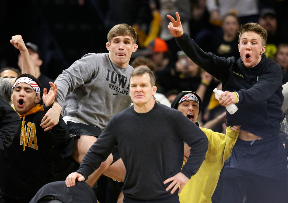 The Iowa bench cheers on cheers on Michael Kemerer in his 174-pound match during their dual at Carver-Hawkeye Arena in Iowa City on Friday, January 31, 2020. (Stephen Mally/hawkeyesports.com)