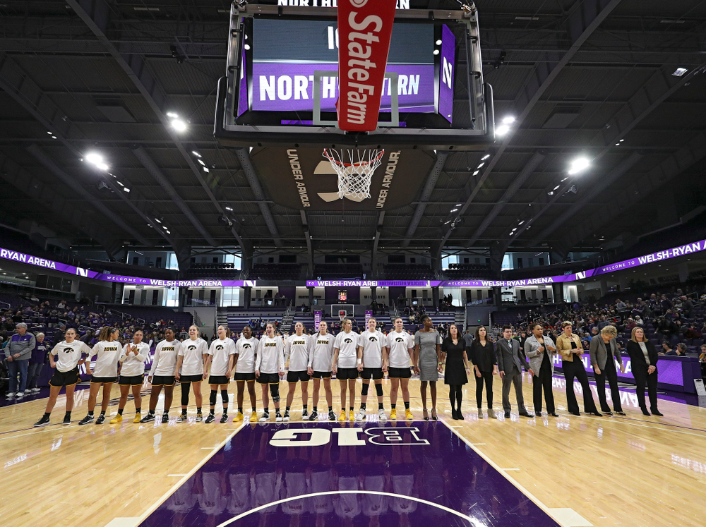 The Hawkeyes stand for the National Anthem before their game at Welsh-Ryan Arena in Evanston, Ill. on Sunday, January 5, 2020. (Stephen Mally/hawkeyesports.com)