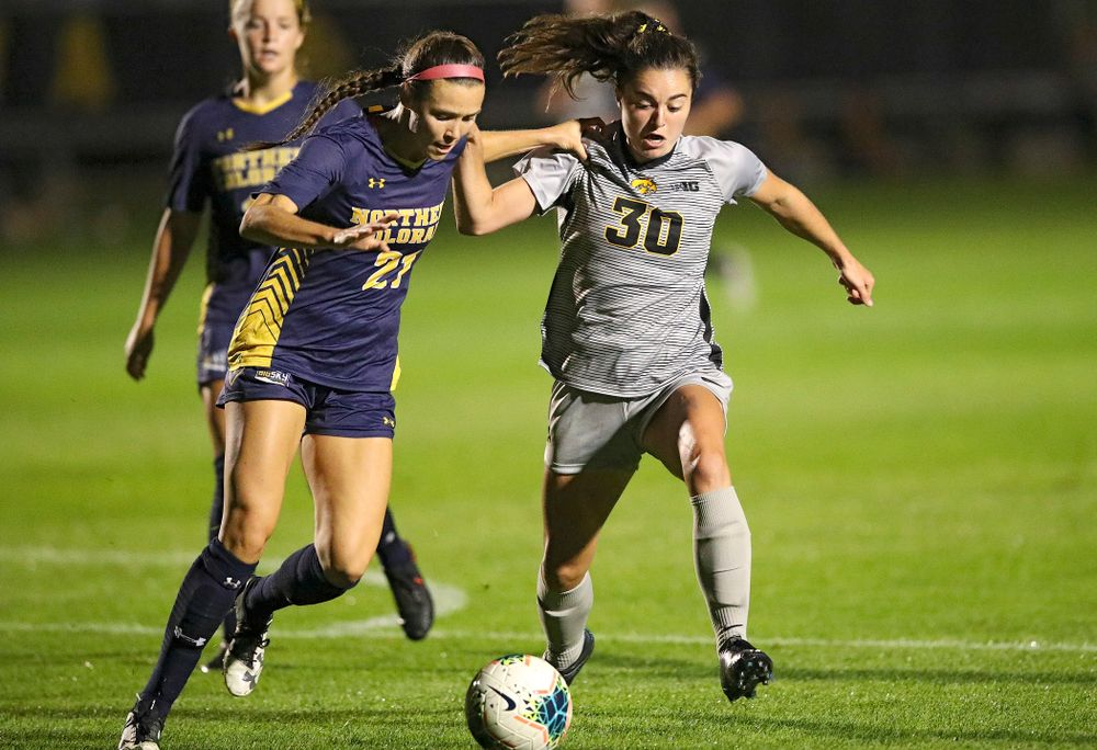 Iowa forward Devin Burns (30) battles for position on the ball during the second half of their match at the Iowa Soccer Complex in Iowa City on Friday, Sep 13, 2019. (Stephen Mally/hawkeyesports.com)