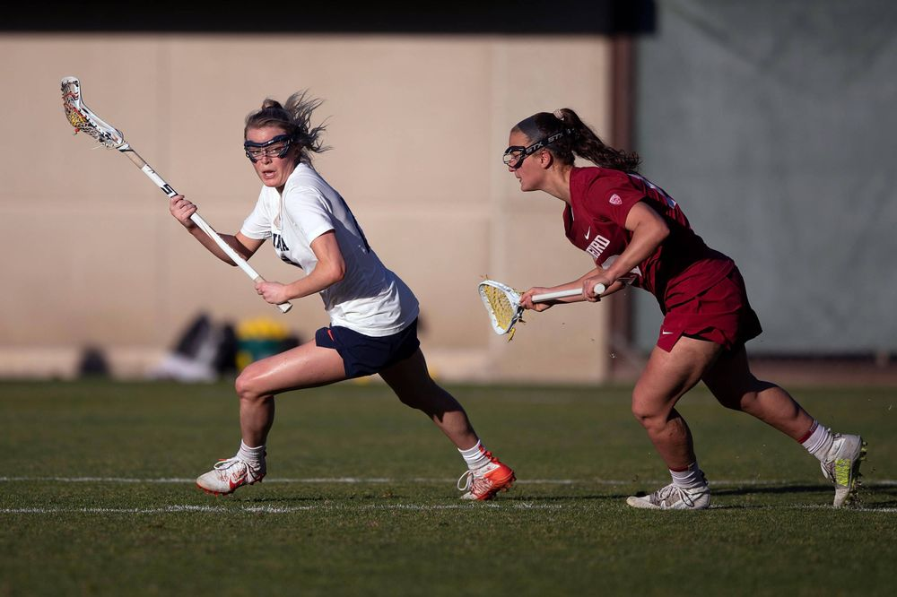 STANFORD, California - FEBRUARY 14:  Virginia Cavaliers midfield Courtlynne Caskin (25) is deafened by Stanford Cardinal defense Maggie Bellaschi (11) during the second half at Cagan Stadium on February 14, 2020 in Stanford, California. The Virginia Cavaliers defeated the Stanford Cardinal 12-11. (Photo by Jason O. Watson)