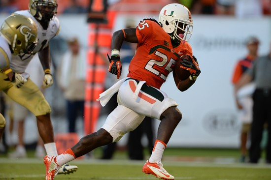 University of Miami Hurricanes running back Dallas Crawford #25 carries the ball in a game against the Georgia Tech Yellow Jackets at Sun Life Stadium...