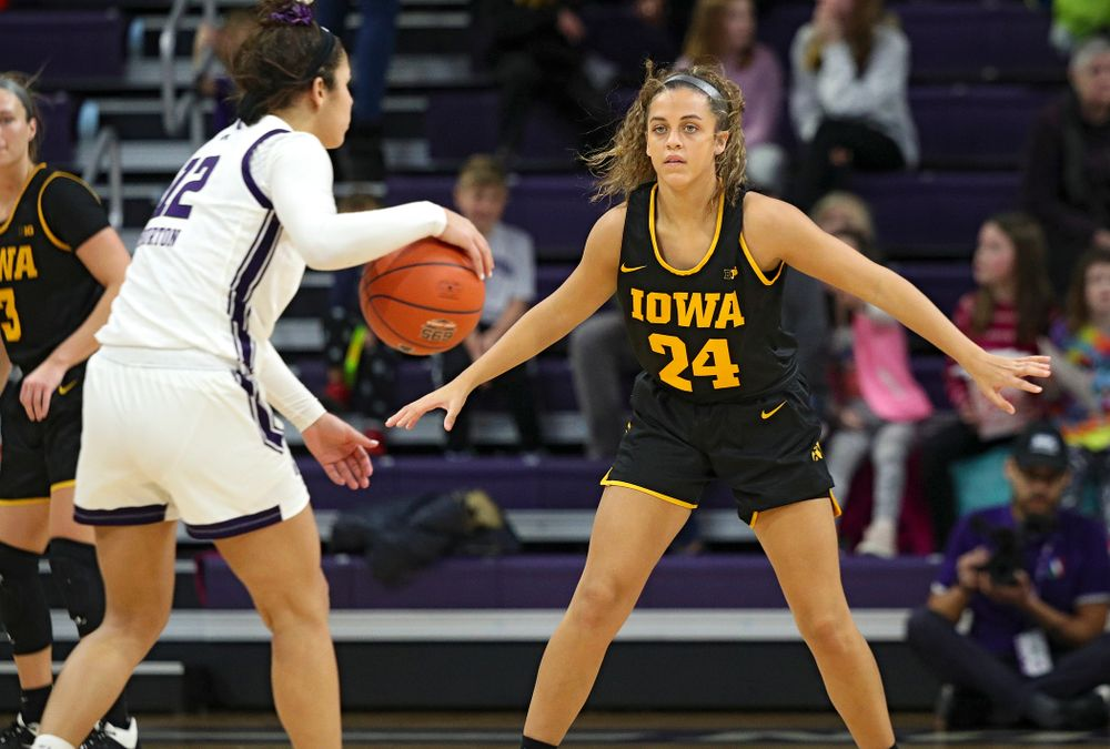 Iowa Hawkeyes guard Gabbie Marshall (24) defends during the third quarter of their game at Welsh-Ryan Arena in Evanston, Ill. on Sunday, January 5, 2020. (Stephen Mally/hawkeyesports.com)