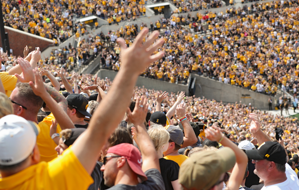 """People look wave to the the University of Iowa Stead Family Children's Hospital as the Pat Green performs """"Wave on Wave"""" during the second quarter of their Big Ten Conference football game at Kinnick Stadium in Iowa City on Saturday, Sep 7, 2019. (Stephen Mally/hawkeyesports.com)"""