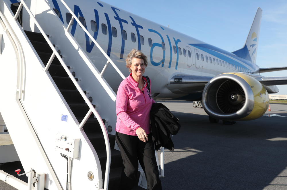 Iowa Hawkeyes head coach Lisa Bluder arrives in Greensboro, NC for the Regionals of the 2019 NCAA Women's Basketball Championships Thursday, March 28, 2019 at the Eastern Iowa Airport. (Brian Ray/hawkeyesports.com)