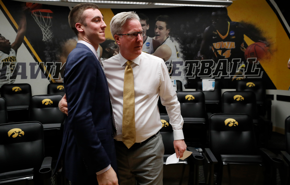 Iowa Hawkeyes head coach Fran McCafferya and guard Connor McCaffery (30)