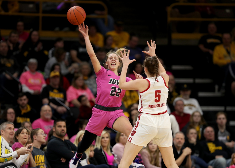 Iowa Hawkeyes guard Kathleen Doyle (22) saves a ball from going out of bounds against the Wisconsin Badgers Sunday, February 16, 2020 at Carver-Hawkeye Arena. (Brian Ray/hawkeyesports.com)