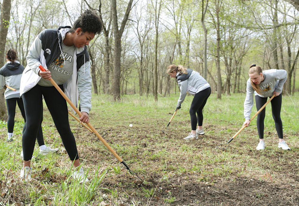 Iowa women's volleyball players prepare the ground for the Woodpecker single track during the 21st annual ISAAC Hawkeye Day of Caring in Coralville on Sunday, Apr. 28, 2019. (Stephen Mally/hawkeyesports.com)