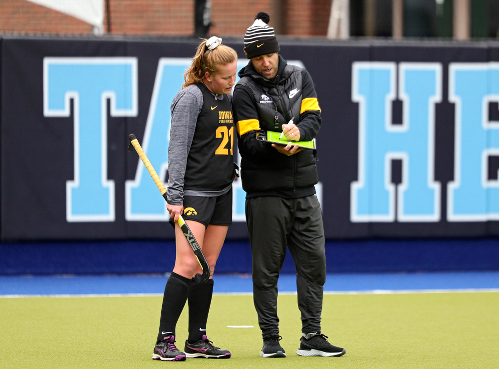 Iowa's Makenna Maguire (21) talks with assistant coach Michael Boal during their practice at Karen Shelton Stadium in Chapel Hill, N.C. on Thursday, Nov 14, 2019. (Stephen Mally/hawkeyesports.com)