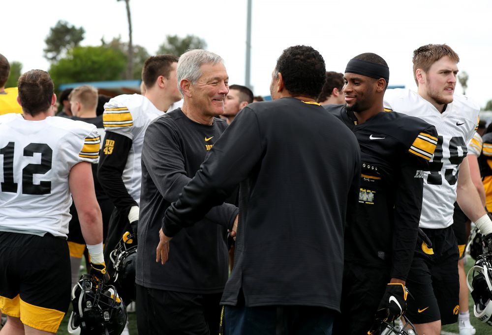 Iowa Hawkeyes head coach Kirk Ferentz shakes hands with former Hawkeye Quinn Early following Holiday Bowl Practice No. 3  Tuesday, December 24, 2019 at San Diego Mesa College. (Brian Ray/hawkeyesports.com)