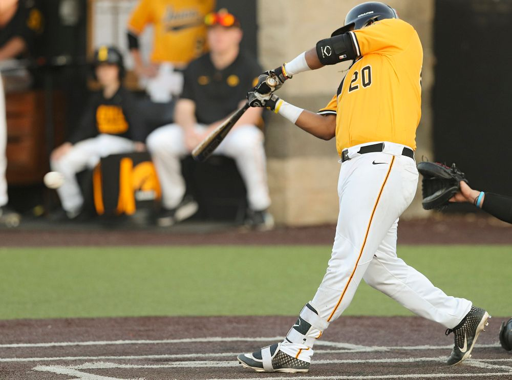 Iowa Hawkeyes first baseman Izaya Fullard (20) hits an RBI single during the eighth inning of their game against Northern Illinois at Duane Banks Field in Iowa City on Tuesday, Apr. 16, 2019. (Stephen Mally/hawkeyesports.com)