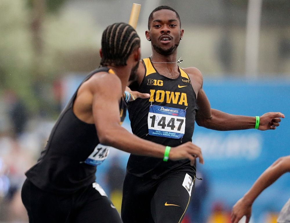 Iowa's Antonio Woodard (right) hands the baton off to Mar'yea Harris runs the men's sprint medley relay event during the third day of the Drake Relays at Drake Stadium in Des Moines on Saturday, Apr. 27, 2019. (Stephen Mally/hawkeyesports.com)