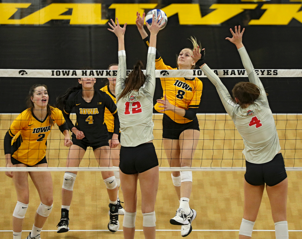 Iowa's Kyndra Hansen (8) lines up a kill during the second set of their match at Carver-Hawkeye Arena in Iowa City on Friday, Nov 29, 2019. (Stephen Mally/hawkeyesports.com)