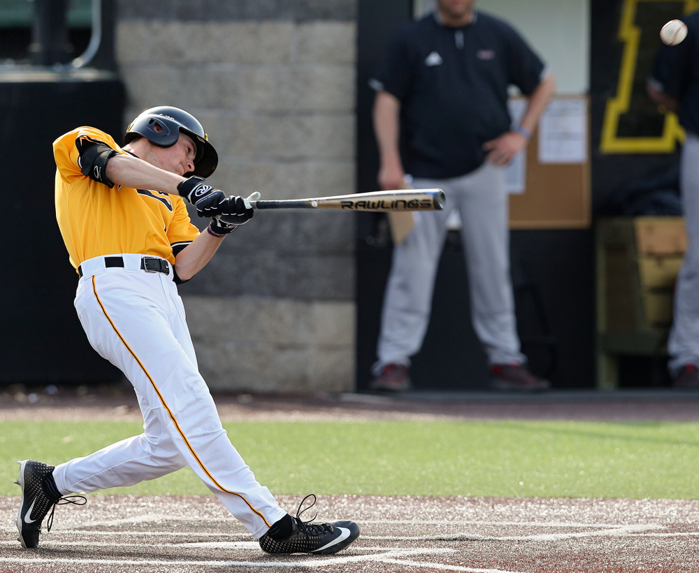 Iowa Hawkeyes center fielder Ben Norman (9) hits an RBI single during the third inning of their game against Northern Illinois at Duane Banks Field in Iowa City on Tuesday, Apr. 16, 2019. (Stephen Mally/hawkeyesports.com)