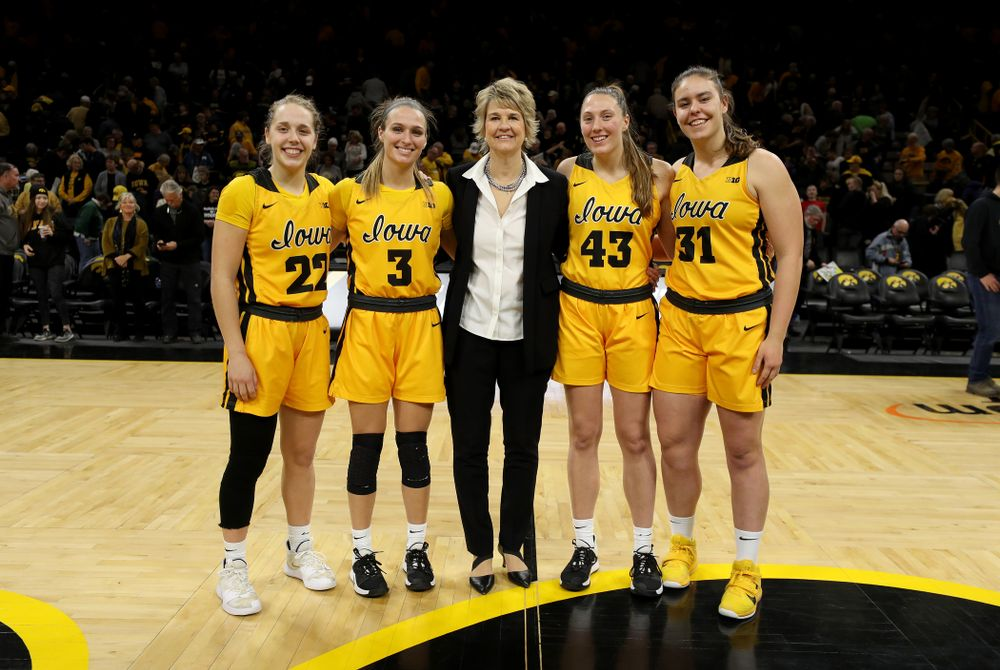 Iowa Hawkeyes head coach Lisa Bluder with seniors Kathleen Doyle, Makenzie Meyer, Amanda Ollinger, and Paula Valiño Ramos during senior day activities following their win over the Minnesota Golden Gophers Thursday, February 27, 2020 at Carver-Hawkeye Arena. (Brian Ray/hawkeyesports.com)