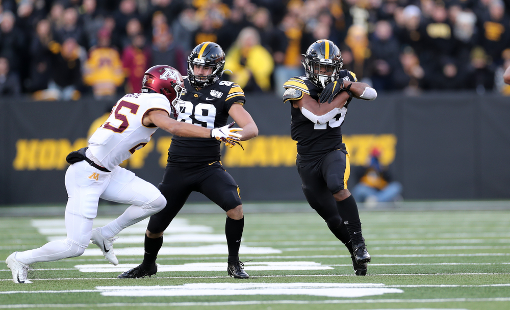 Iowa Hawkeyes running back Tyler Goodson (15) picks up a first down against the Minnesota Golden Gophers Saturday, November 16, 2019 at Kinnick Stadium. (Brian Ray/hawkeyesports.com)
