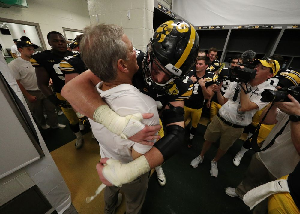 Iowa Hawkeyes head coach Kirk Ferentz and defensive end Matt Nelson (96) during their Outback Bowl Tuesday, January 1, 2019 at Raymond James Stadium in Tampa, FL. (Brian Ray/hawkeyesports.com)