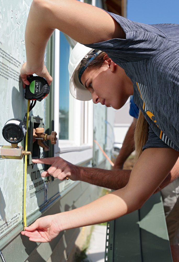 Iowa's Megan Meyer works on a Habitat for Humanity Women Build project in Iowa City on Wednesday, Sep 25, 2019. (Stephen Mally/hawkeyesports.com)