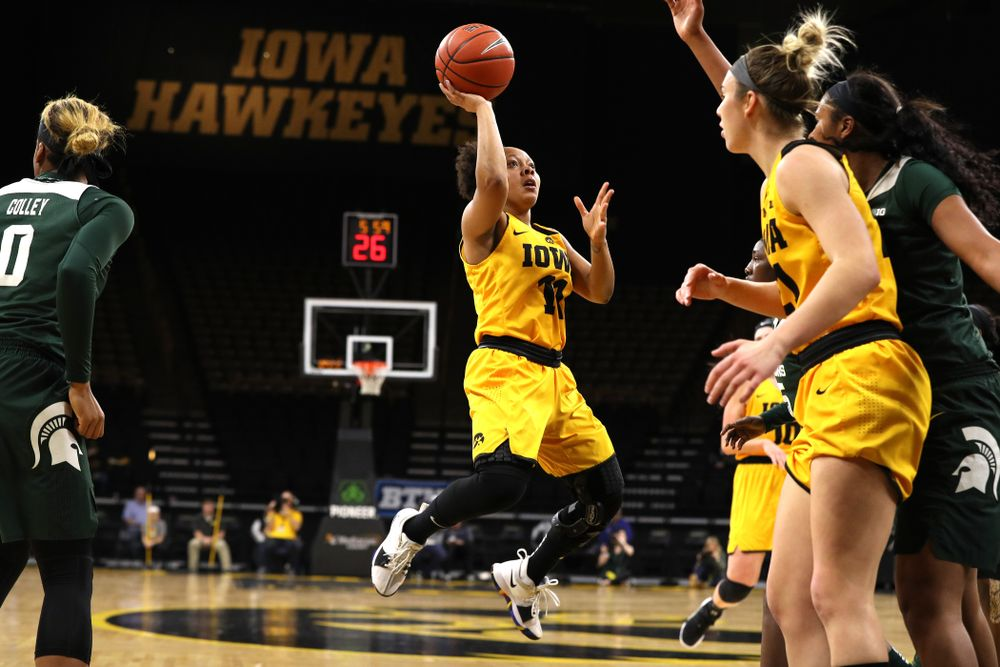 Iowa Hawkeyes guard Tania Davis (11) against the Michigan State Spartans Thursday, February 7, 2019 at Carver-Hawkeye Arena. (Brian Ray/hawkeyesports.com)