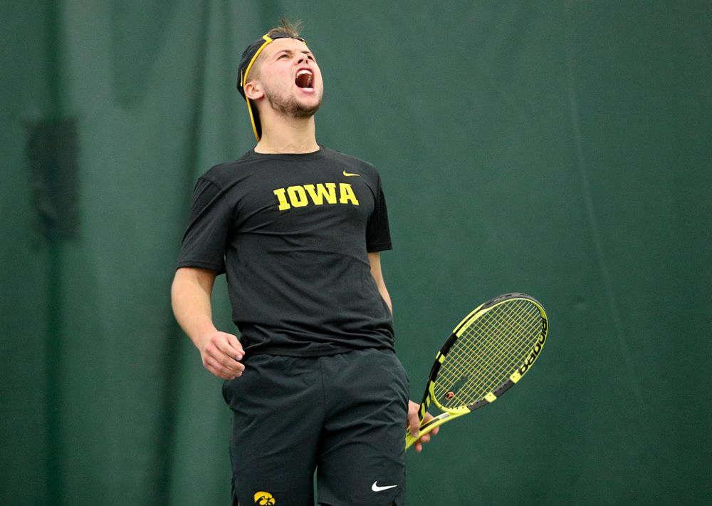 Iowa's Will Davies celebrates a point during their match at the Hawkeye Tennis and Recreation Complex in Iowa City on Thursday, January 16, 2020. (Stephen Mally/hawkeyesports.com)