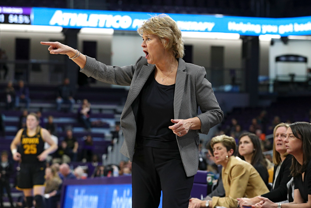 Iowa Hawkeyes head coach Lisa Bluder directs her team during the fourth quarter of their game at Welsh-Ryan Arena in Evanston, Ill. on Sunday, January 5, 2020. (Stephen Mally/hawkeyesports.com)
