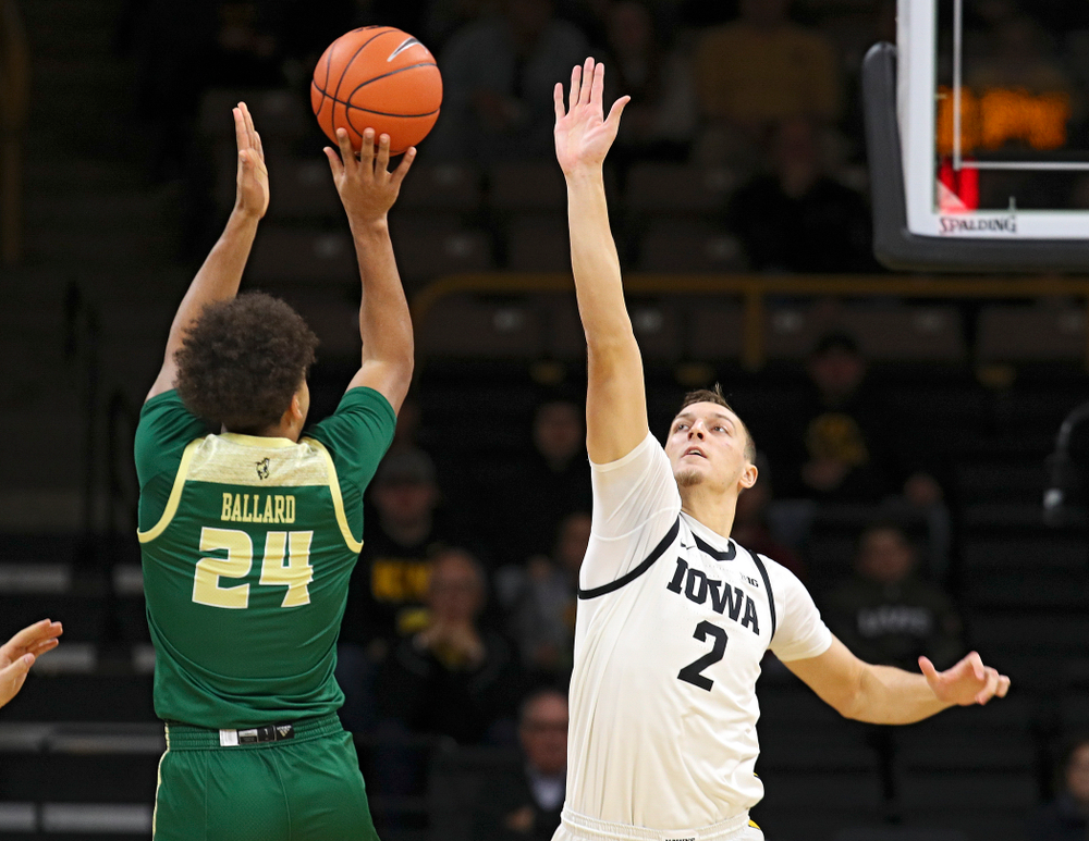 Iowa Hawkeyes forward Jack Nunge (2) tries to block a shot during the first half of their game at Carver-Hawkeye Arena in Iowa City on Sunday, Nov 24, 2019. (Stephen Mally/hawkeyesports.com)