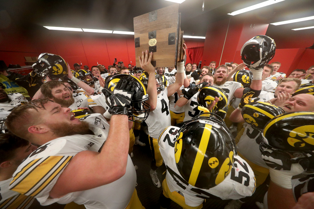 The Iowa Hawkeyes sing the Fight Song as they celebrate their victory against the Nebraska Cornhuskers Friday, November 29, 2019 at Memorial Stadium in Lincoln, Neb. (Brian Ray/hawkeyesports.com)
