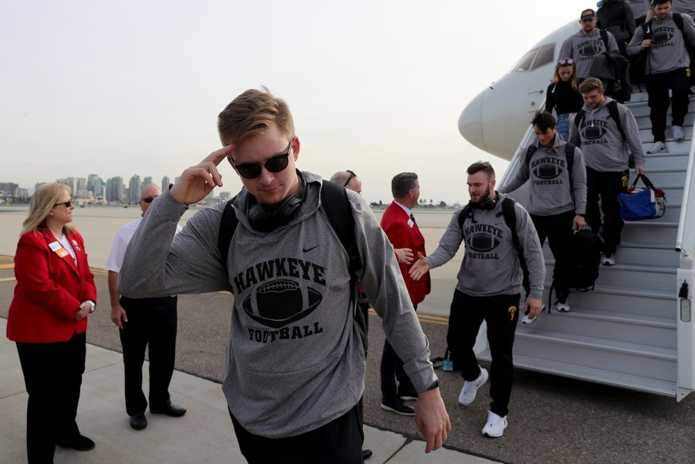 Iowa Hawkeyes quarterback Spencer Petras (7) solutes after arriving in San Diego, CA Saturday, December 21, 2019 for the Holiday Bowl. (Brian Ray/hawkeyesports.com)