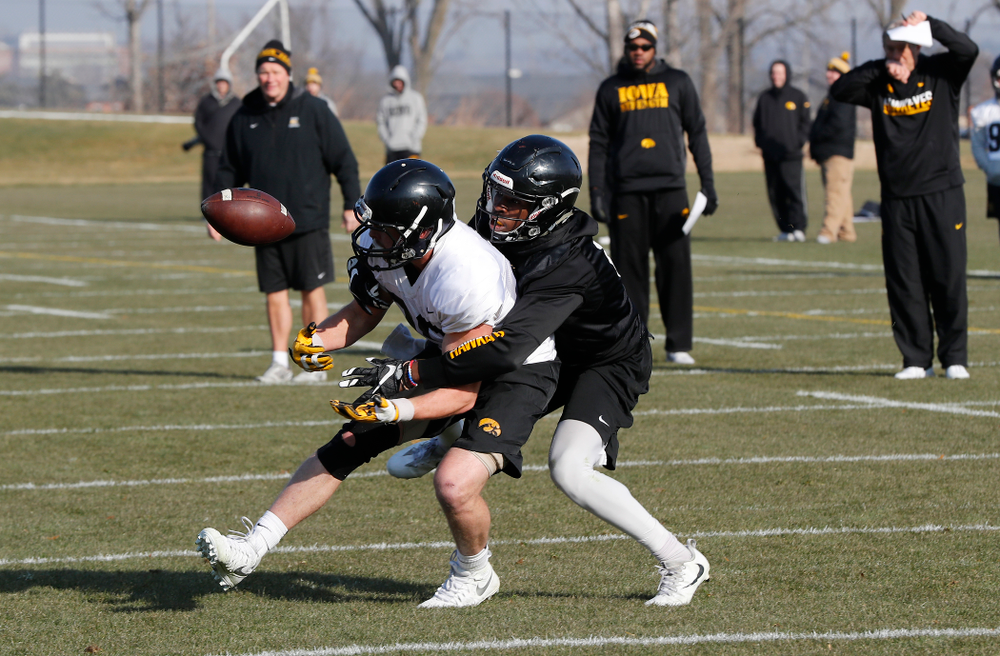 Iowa Hawkeyes wide receiver Matt VandeBerg (89) and Iowa Hawkeyes defensive back Matt Hankins (8)