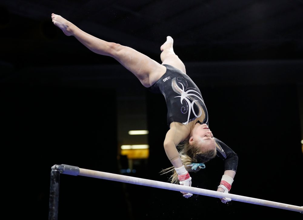 Iowa's Charlotte Sullivan competes on the bars against the Nebraska Cornhuskers