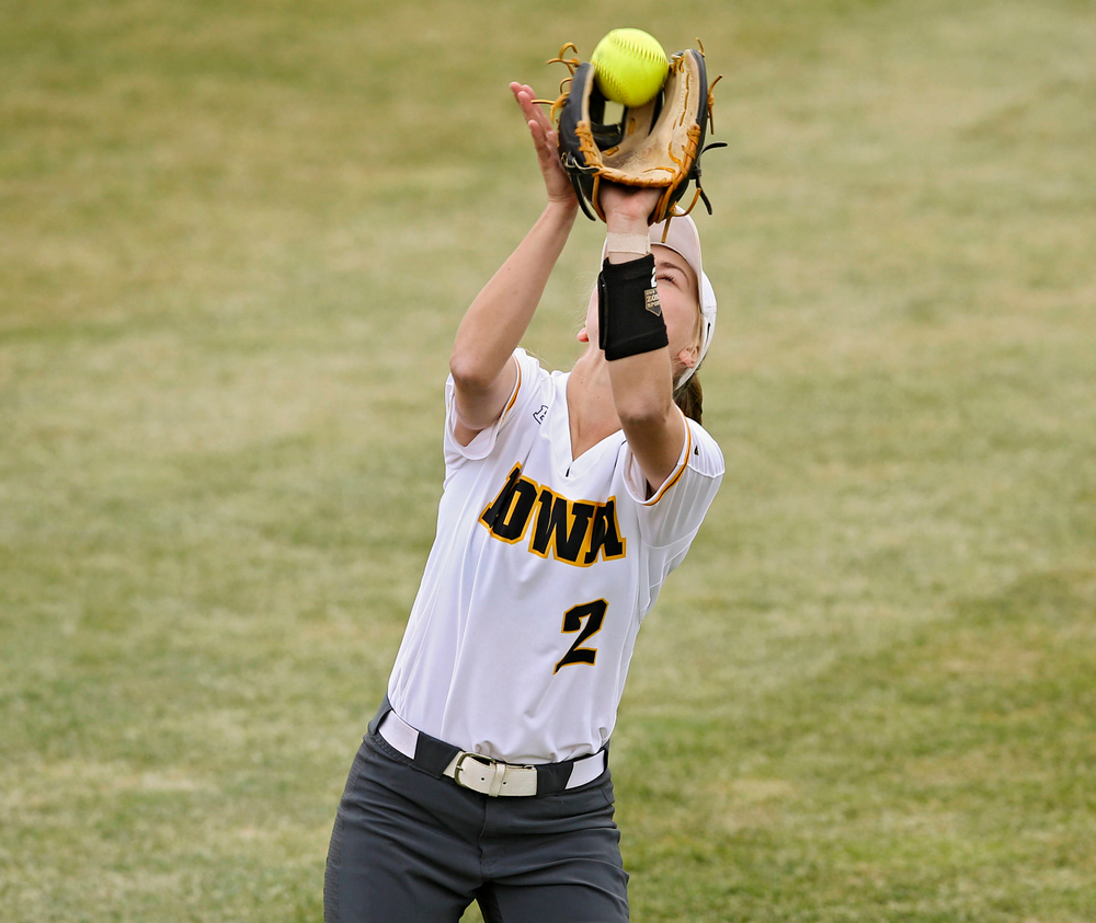 Iowa Hawkeyes Aralee Bogar (2) pulls in a pop up for an out during the fourth inning of their Big Ten Conference softball game at Pearl Field in Iowa City on Friday, Mar. 29, 2019. (Stephen Mally/hawkeyesports.com)