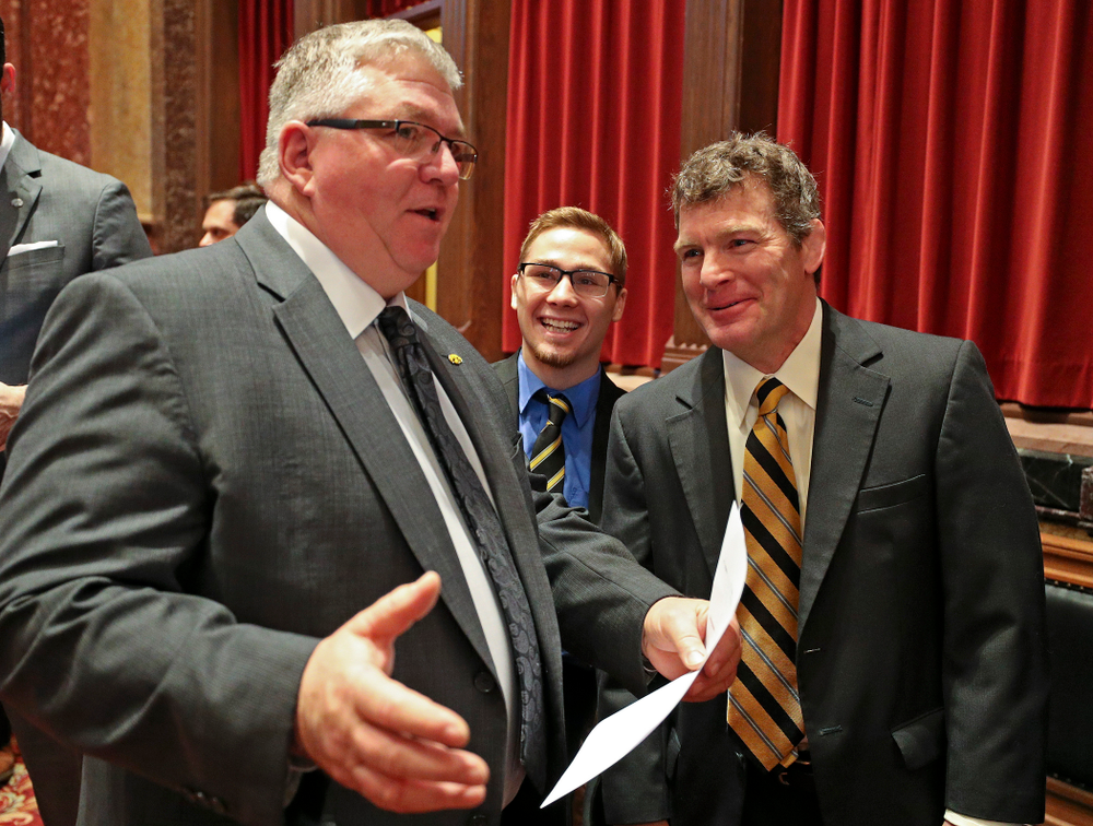State Sen. Dan Zumbach (from left) talks with Iowa's Spencer Lee and head coach Tom Brands in the Senate Chamber at the Iowa State Capitol Building on Tuesday, Apr. 9, 2019. (Stephen Mally/hawkeyesports.com)