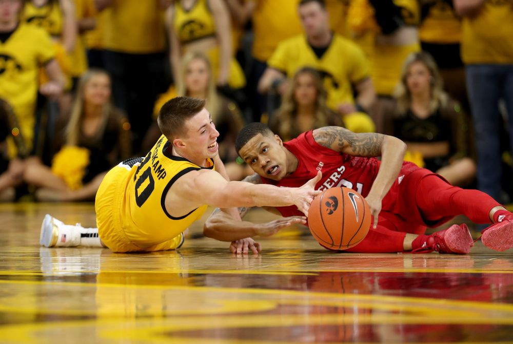 Iowa Hawkeyes guard Joe Wieskamp (10) battles for a loose ball against the Rutgers Scarlet Knights  Wednesday, January 22, 2020 at Carver-Hawkeye Arena. (Brian Ray/hawkeyesports.com)