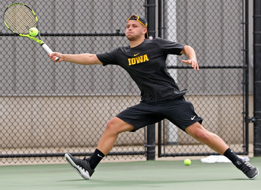 Iowa's Will Davies competes during a match against Ohio State at the Hawkeye Tennis and Recreation Complex in Iowa City on Sunday, Apr. 7, 2019. (Stephen Mally/hawkeyesports.com)