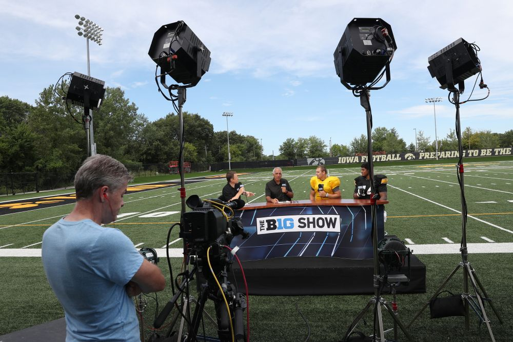 Iowa Hawkeyes quarterback Nate Stanley (4) and offensive lineman Tristan Wirfs (74) on the set of the BTN Tailgate Tour following fall camp Practice No. 16 Tuesday, August 20, 2019 at the Ronald D. and Margaret L. Kenyon Football Practice Facility. (Brian Ray/hawkeyesports.com)