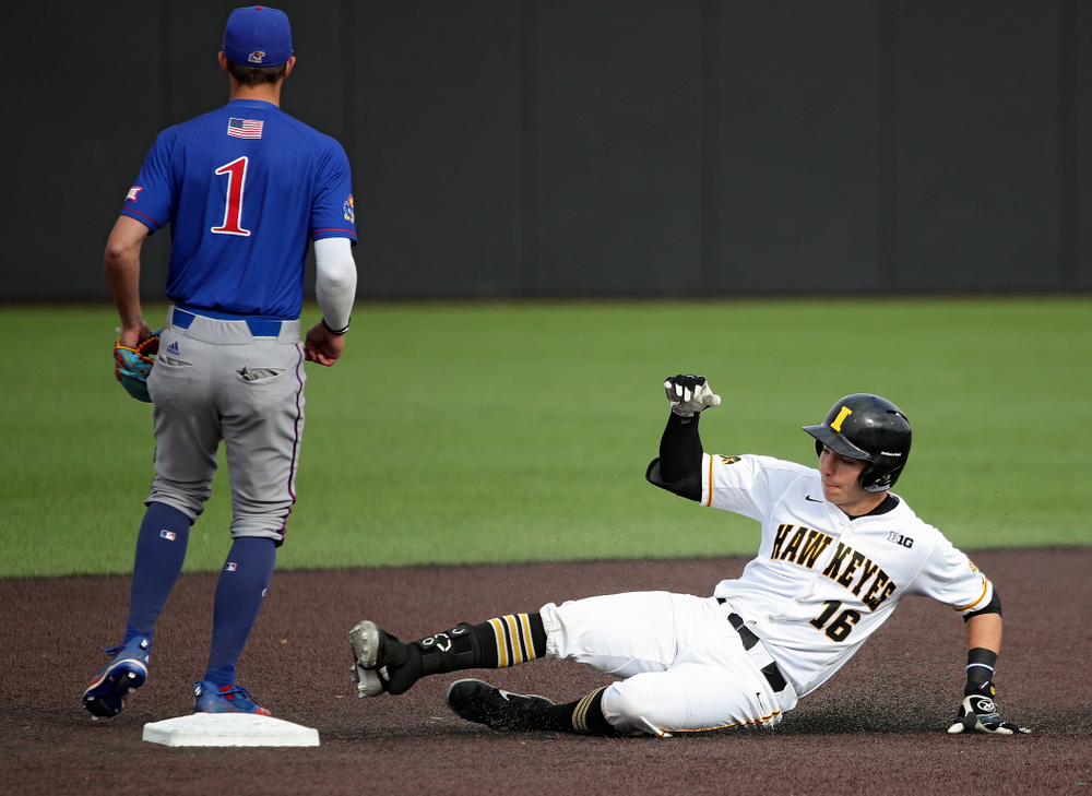 Iowa catcher Tyler Snep (16) slides into second base after hitting a double during the seventh inning of their college baseball game at Duane Banks Field in Iowa City on Wednesday, March 11, 2020. (Stephen Mally/hawkeyesports.com)