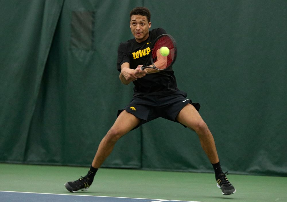 Iowa's Oliver Okonkwo returns a shot during his singles match at the Hawkeye Tennis and Recreation Complex in Iowa City on Friday, March 6, 2020. (Stephen Mally/hawkeyesports.com)