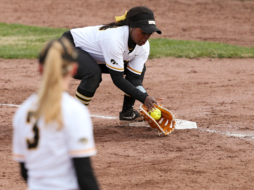 Iowa first baseman DoniRae Mayhew (24) fields a ground ball hit down the line during the fourth inning of their game against Illinois at Pearl Field in Iowa City on Friday, Apr. 12, 2019. (Stephen Mally/hawkeyesports.com)