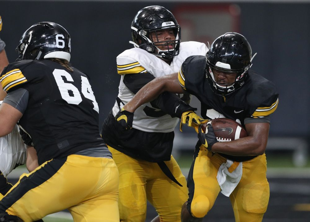 Iowa Hawkeyes defensive lineman Noah Shannon (99) and running back Ivory Kelly-Martin (21) During Fall Camp Practice No. 6 Thursday, August 8, 2019 at the Ronald D. and Margaret L. Kenyon Football Practice Facility. (Brian Ray/hawkeyesports.com)