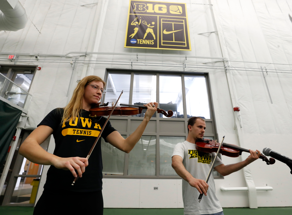 Iowa Diver Anton Hoherz and Women's Tennis Player Montana Crawford play the National Anthem before the Iowa Hawkeyes game against Purdue Sunday, April 15, 2018 at the Hawkeye Tennis and Recreation Center. (Brian Ray/hawkeyesports.com)