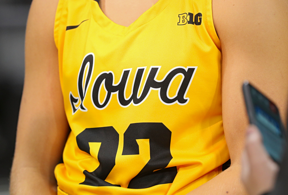 Iowa guard Kathleen Doyle (22) wears a new alternate uniform as she answers questions during Iowa Women's Basketball Media Day at Carver-Hawkeye Arena in Iowa City on Thursday, Oct 24, 2019. (Stephen Mally/hawkeyesports.com)