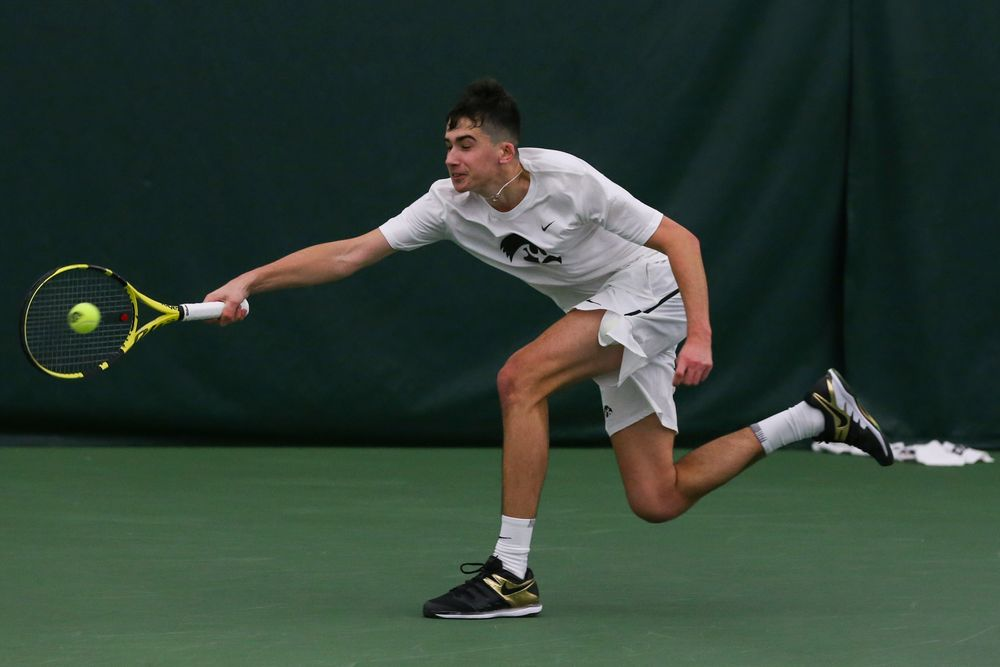 Iowa's Matt Clegg dives for a forehand during the Iowa men's tennis match vs Western Michigan on Saturday, January 18, 2020 at the Hawkeye Tennis and Recreation Complex. (Lily Smith/hawkeyesports.com)