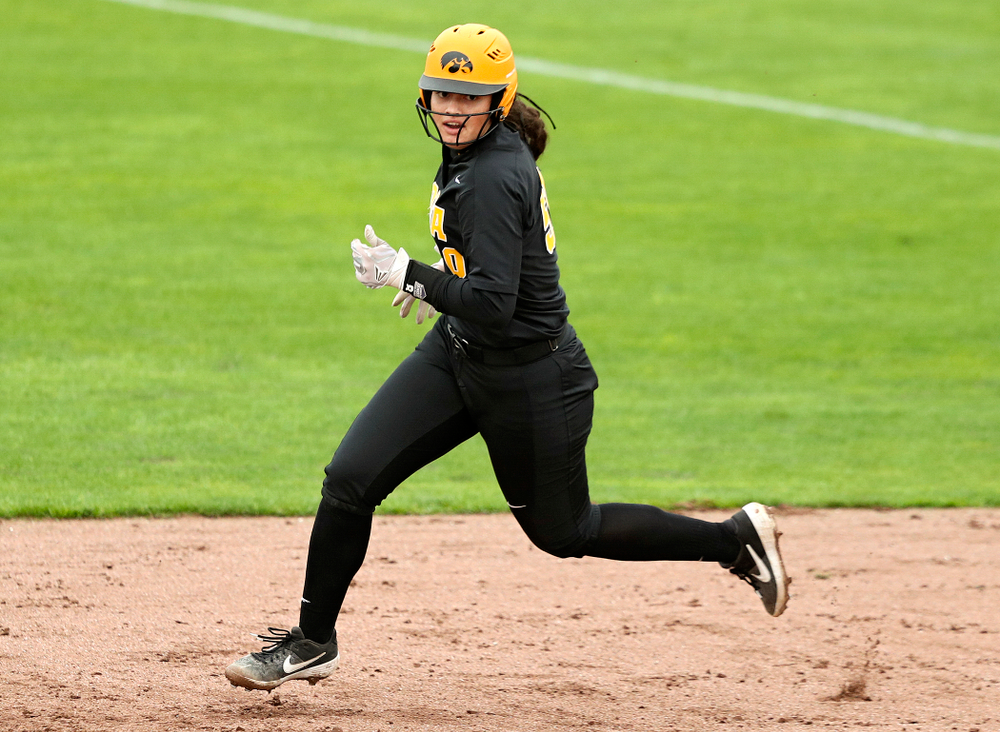 Iowa infielder Kalena Burns (50) runs to second after hitting a double during the fourth inning of their game against Iowa Softball vs Indian Hills Community College at Pearl Field in Iowa City on Sunday, Oct 6, 2019. (Stephen Mally/hawkeyesports.com)
