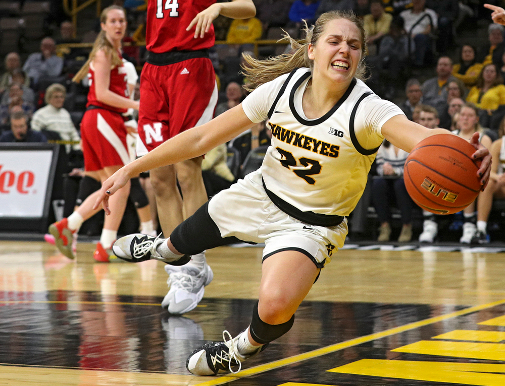 Iowa Hawkeyes guard Kathleen Doyle (22) tries to save the ball from going out of bounds during the fourth quarter of the game at Carver-Hawkeye Arena in Iowa City on Thursday, February 6, 2020. (Stephen Mally/hawkeyesports.com)
