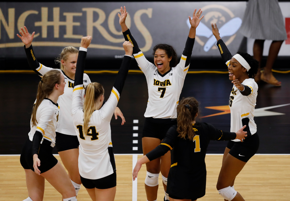 Iowa Hawkeyes setter Gabrielle Orr (7), right side hitter Reghan Coyle (8), and outside hitter Taylor Louis (16) against Eastern Illinois Sunday, September 9, 2018 at Carver-Hawkeye Arena. (Brian Ray/hawkeyesports.com)